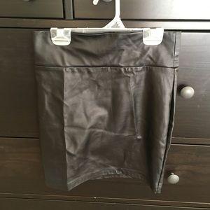 Mini leather skirt. Needisaymore.